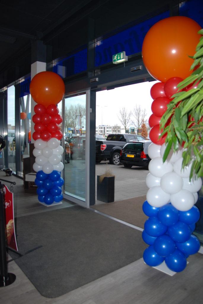 De Ballonnenkoning - ballonpilaren - rood wit blauw - oranje topballon