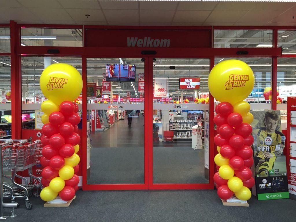 De Ballonnenkoning - ballonpilaren - rood geel - geel bedrukte topballon
