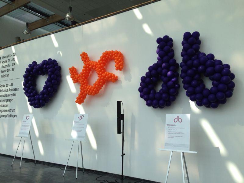 De ballonnenkoning - ballon kunst - hart - symbolen - oranje paars