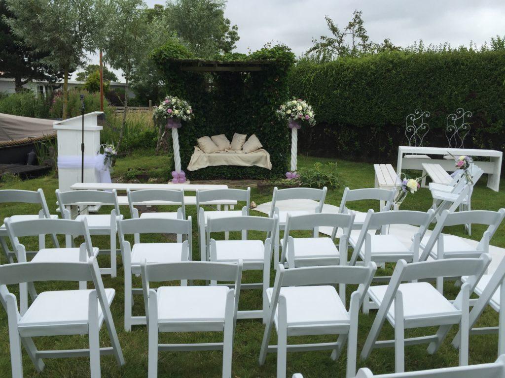 De Ballonnenkoning - Meerhoeve - decoratie ballonnen en bloemen stoelen